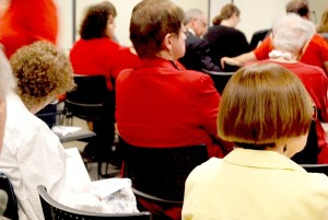 """Supporters of the Brook Run Dog Park wore red to the June 9 council meeting to """"make a visual impact"""" according to the Brook Run Dog Park Association's Facebook page. Photo by Lauren Ramsdell"""
