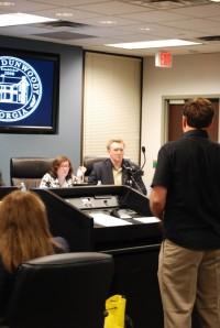 A representative of Treetop Quest, LLC addresses Dunwoody council members Lynn Deutsch and John Heneghan. Photo by Lauren Ramsdell.