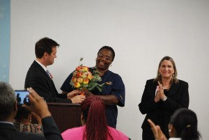LaTasha Clark, a student at Medtech College, is presented with a dozen roses for Mothers' Day. Photo by Lauren Ramsdell.