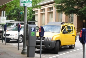 Downtown Decatur's parking meters are now electronic and take credit cards as well as coins. Photo by Lauren Ramsdell.